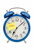 stock photo of arousal  - an alarm clock with a sticky note - JPG