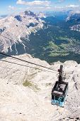 foto of ascending  - Cable car ascending from the valley Tofane Cortina d - JPG