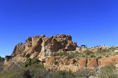 foto of magma  - Picturesque Magma ridge rocks in Boyce Thompson Arboretum State Park - JPG