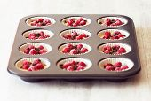 Unripe Muffins Placed In Black Tray