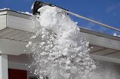 picture of soffit  - Raking snow on the roof in winter time - JPG