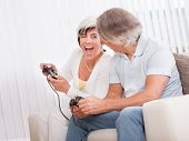 Middle-aged Couple Playing Computer Games