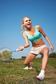 pic of badminton player  - badminton player in action  - JPG
