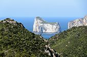 "picture of fraction  - ""Sugar Loaf"" is a cliff that rises from the sea at a short distance from the coast, near Planusartu fraction of Iglesias, in the south-west coast of Sardinia.