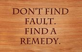 Don't find fault.  Find a remedy - on wooden red oak background