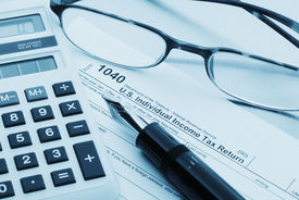 stock photo of cpa  - Tax preparation with fountain pen, calculator, glasses and forms ** Note: Shallow depth of field - JPG