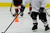 foto of hockey arena  - A group of kids practicing ice hockey - JPG