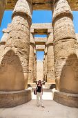 foto of ancient civilization  - Female tourist in Ancient Egyptian Temple of Karnak  - JPG