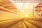 picture of high-speed train  - Departure of high speed train at sunset - JPG