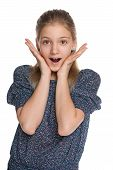stock photo of preteen  - A portrait of a surprised preteen girl on the white background - JPG