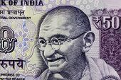 stock photo of gandhi  - Closeup macro view of Mahatma Gandhi on an Indian currency note - JPG