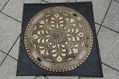 stock photo of manhole  - Old style of manhole in central Budapest Hungary  - JPG
