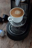 foto of brew  - Cup of freshly brewed espresso from a capsule - JPG