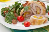 image of kale  - Tasty chicken prosciutto roulade stuffed with cheese and pineapple served with baby kale grapes and cherry tomatoes salad - JPG