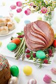 foto of ester  - Whole baked honey sliced ham with fresh raspberry asparagus dyed Ester eggs Easter cake and cross buns - JPG