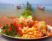 pic of lobster  - Lobster thermidor baked lobster served with shrimp cocktail and French fries - JPG