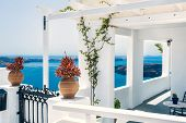 stock photo of greek-architecture  - Greek house with terrace and sea view - JPG