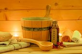 pic of sauna  - wooden sauna and sauna accessories in the candlelight - JPG