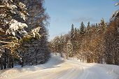 image of icy road  - Danger and fast turn at the icy snow road - JPG