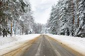 picture of icy road  - Danger and fast turn at the icy snow road - JPG