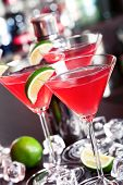 stock photo of cosmopolitan  - A cosmopolitan or informally cosmo is a cocktail made with vodka triple sec cranberry juice and freshly squeezed lime juice or sweetened lime juice - JPG