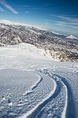 picture of oblique  - Free ride ski tracks on snowy slope - JPG