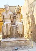 stock photo of pharaohs  - The ruined statues of the ancient Egyptian Pharaohs located in the central corridor of the Luxor Temple Egypt - JPG