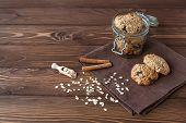 foto of baked raisin cookies  - oatmeal cookies and jar with cookies close - JPG