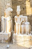 stock photo of pharaoh  - The ruined statues of the ancient Egyptian Pharaohs located in the central corridor of the Luxor Temple Egypt - JPG