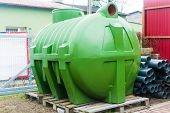 picture of septic  - huge green plastic septic tank standing on a pallet - JPG