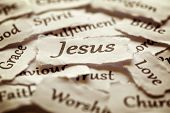 stock photo of evangelism  - Torn paper words of religion with focus on word Jesus - JPG