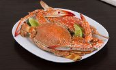 pic of cooked blue crab  - Boiled crabs with lime on the wood background
