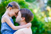 image of father daughter  - Happy father and his adorable little daughter outdoors - JPG