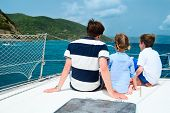 stock photo of boat  - Father and kids sailing on a luxury yacht or catamaran boat - JPG