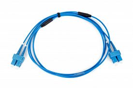 stock photo of duplex  - blue fiber optic duplex SC connector patchcord on white background - JPG