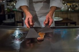 stock photo of wagyu  - Chef cooking wagyu beef in Japanese teppanyaki restaurant Tokyo very shallow focus - JPG