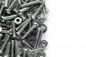 stock photo of bolts  - Nuts and bolts background - JPG