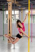 pic of pole dance  - Image of young woman during pole dance training - JPG