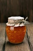 foto of jar jelly  - Orange homemade jam marmelade in glass jar on wooden table - JPG