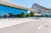 stock photo of gibraltar  - Building of Gibraltar International Airport Terminal with Gibraltar Rock in the background - JPG