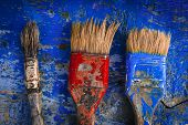 stock photo of bristle brush  - to draw a picture the manuscript of the artist a brush with paints brushes on a board three brushes brushes and paint - JPG