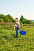 foto of frisbee  - Girl playing frisbee in the park in summer - JPG