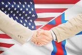 image of faro  - Businessmen shaking hands  - JPG