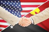stock photo of papua new guinea  - Businessmen shaking hands  - JPG