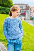 stock photo of pullovers  - Fashion portrait of a pretty little girl of 7 years old - JPG