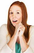 stock photo of single woman  - Wishful single European woman with folded hands - JPG