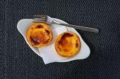 foto of pasteis  - Pastel de Belem or Nata typical Portuguese egg tart pastry - JPG