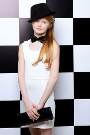 image of bow tie hair  - Elegant teen girl wearing white dress - JPG