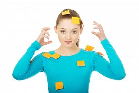pic of post-teen  - Beautiful young woman covered with post it notes - JPG