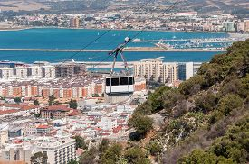 image of gibraltar  - View of the city of Gibraltar and cable car close to the top of Gibraltar rock - JPG